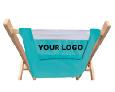 Logochair aus Holz mit hellblauen Bezug