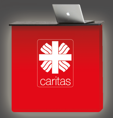 Rote Werbetheke mit Caritas Logo
